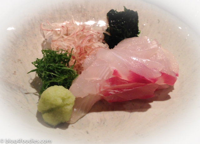 Sea Bream garnished with fresh seaweed and Japanese herbs and Snow Crab topped with crab innards with broth jelly.