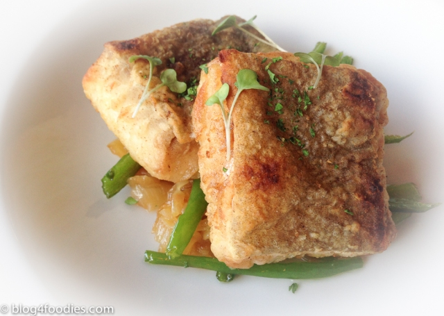 Fried cod with caramelized onions