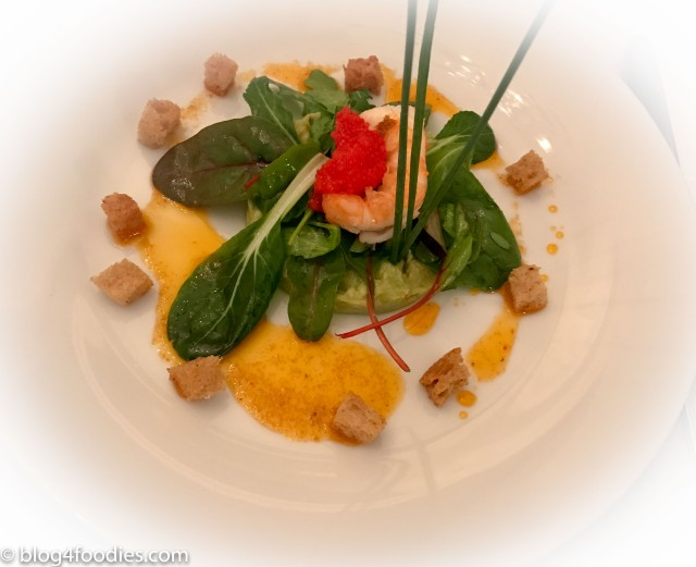 Lobster with caviar, citronette and avocado cream served on a bed of lettuce topped with croutons
